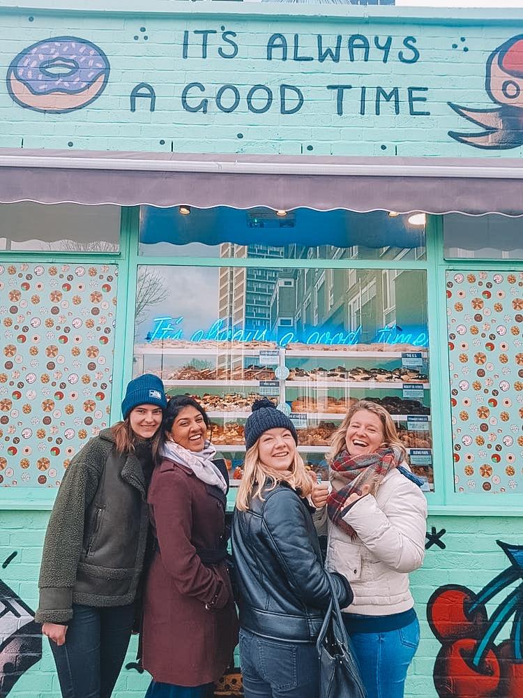 A very Shoreditch donut shop with colourful graffiti facade