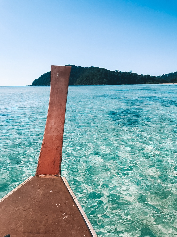 Cruising in a long tail boat in the Surin Islands, Thailand