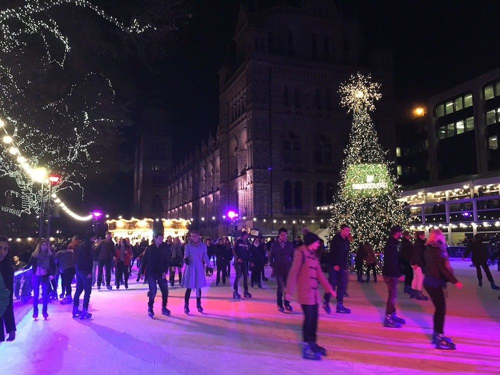 Ice skating at the Natural History Museum in London - one of the best areas to stay in London for families