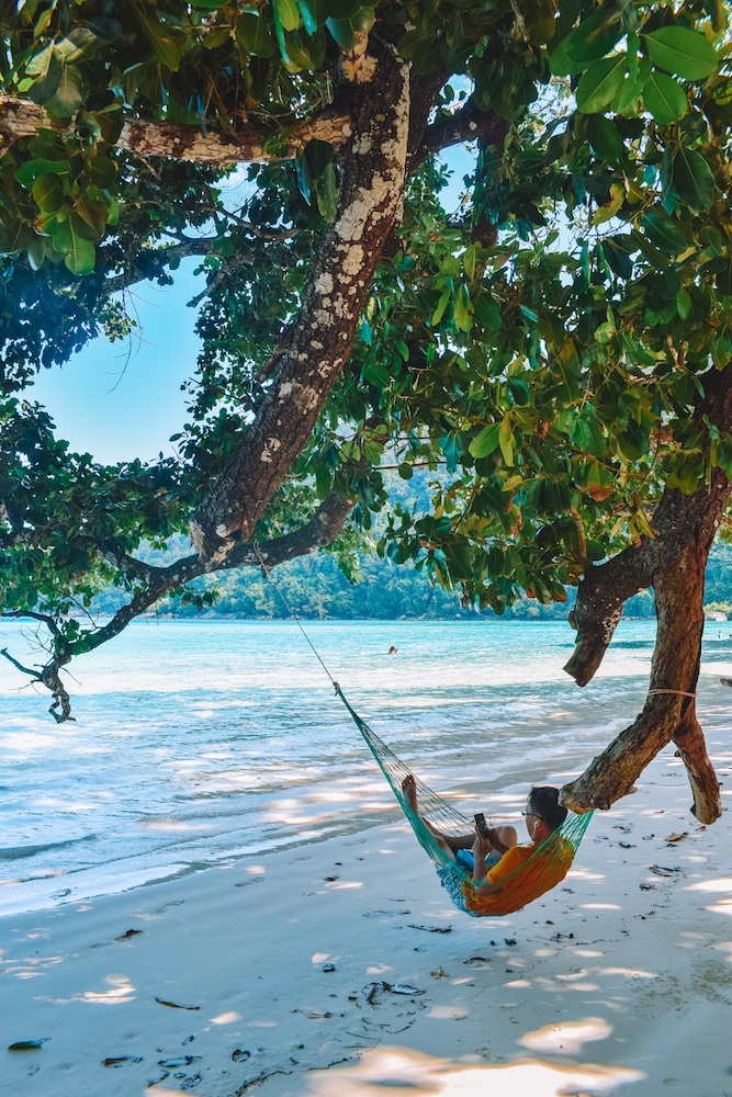 Relaxing on one of the many hammocks in Mai Ngam Beach in Koh Surin Neua, Thailand