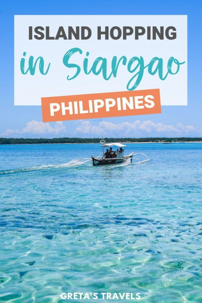 """Photo of a typical Filipino boat cruising in the clear water of Siargao with text overlay saying """"Island hopping in Siargao, Philippines"""""""