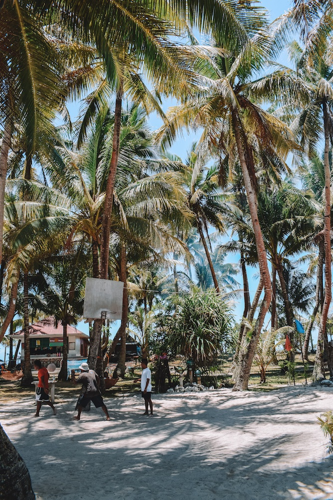 The basketball court in the shade of the palm trees on Guyam Island