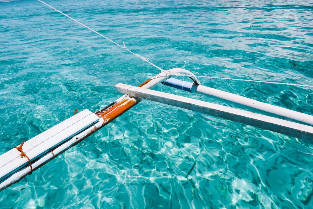 The clear turquoise water you will see while island hopping in Siargao, Philippines