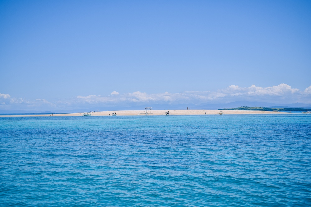Naked Island from a distance, one of the main stops when you go island hopping in Siargao, Philippines