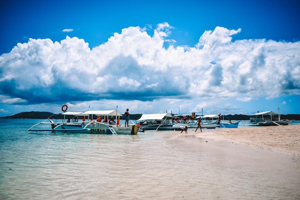 Traditional Filipino boats on Naked Island