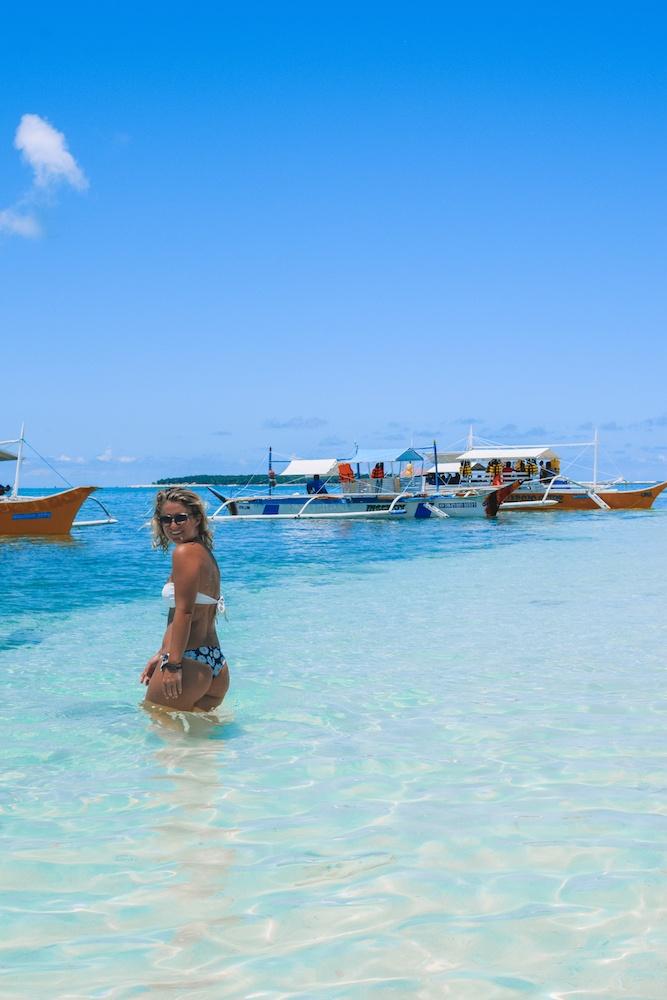 Enjoying the beautiful water of Naked Island in Siargao
