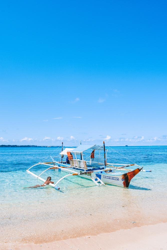 Enjoying the beach in Naked Island, Siargao
