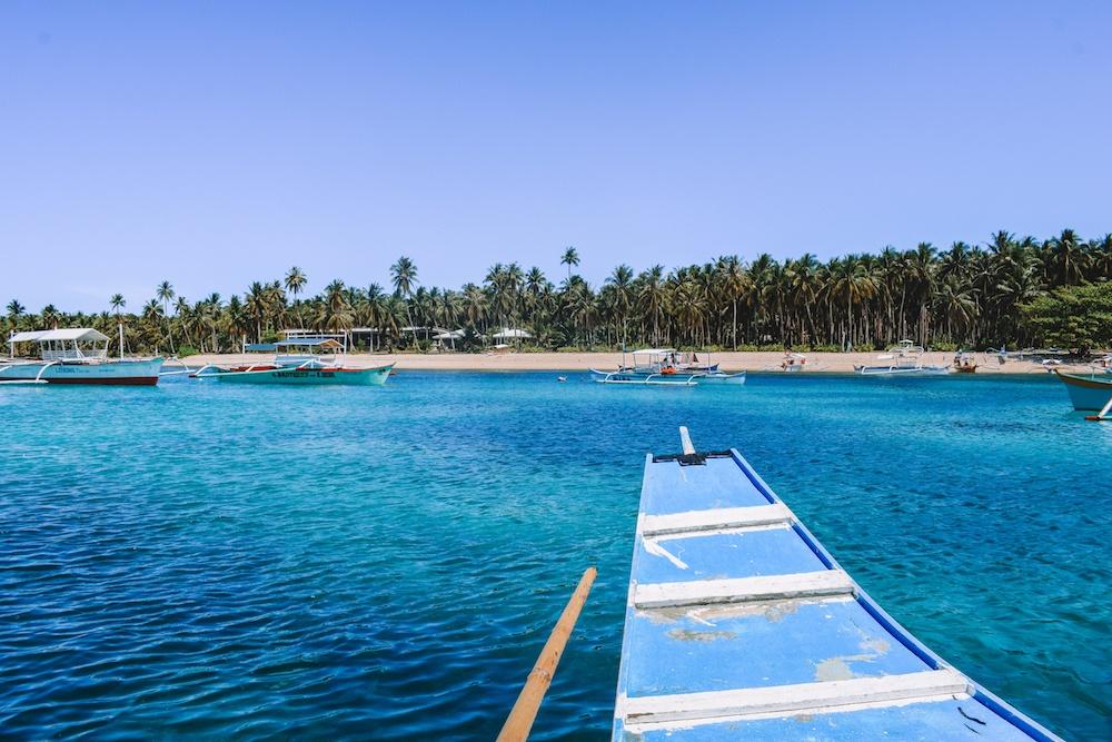 Approaching Daku Island while island hopping in Siargao