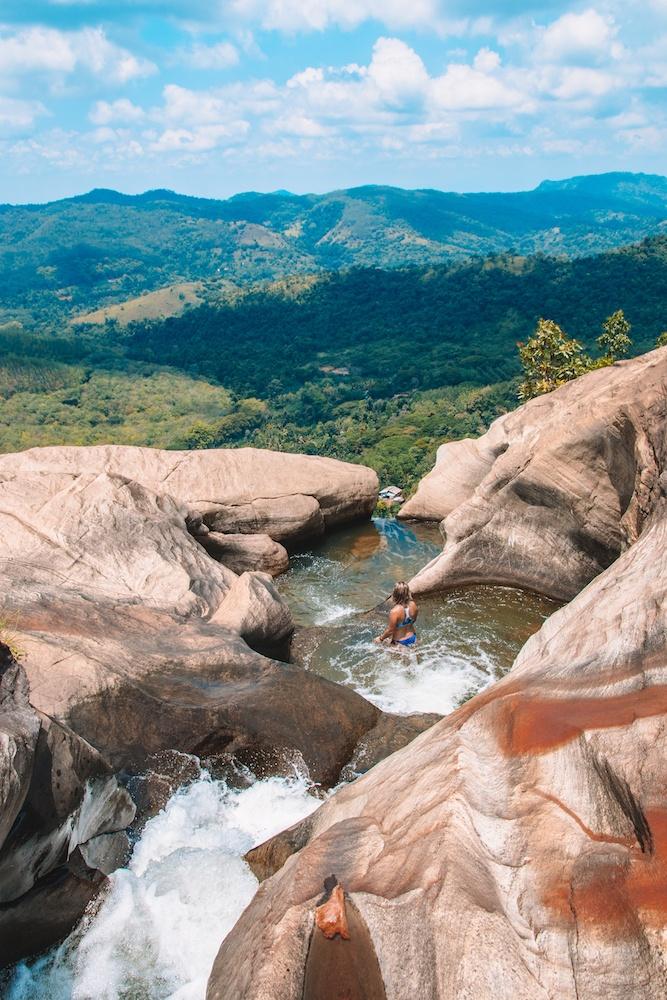 Swimming in the rock pools at the top of Diyaluma Falls in Sri Lanka