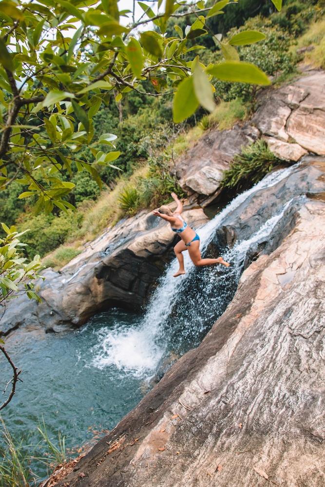 Cliff diving in the waterfalls of Diyaluma Falls, Sri Lanka