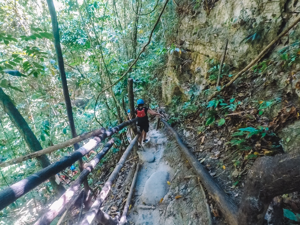 Hiking to the top of Kawasan Falls, where you will then start your canyoneering tour