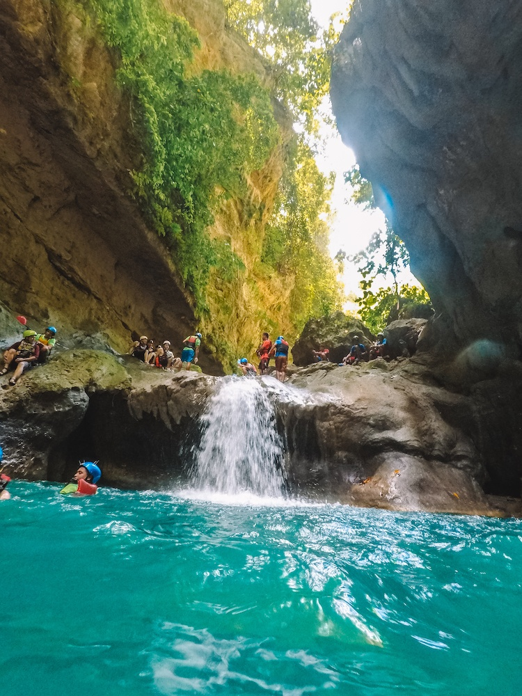 One of the small waterfalls you will slide down while canyoneering in Kawasan Falls