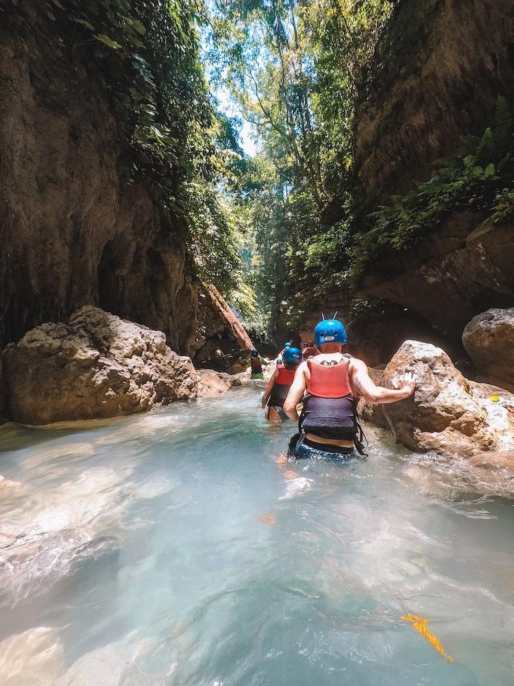 Wading through the river in Kawasan Falls