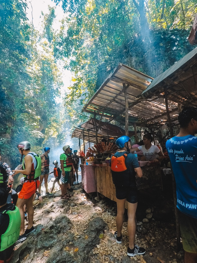 Some of the many food shacks you will find alongside the river while canyoneering in Kawasan Falls