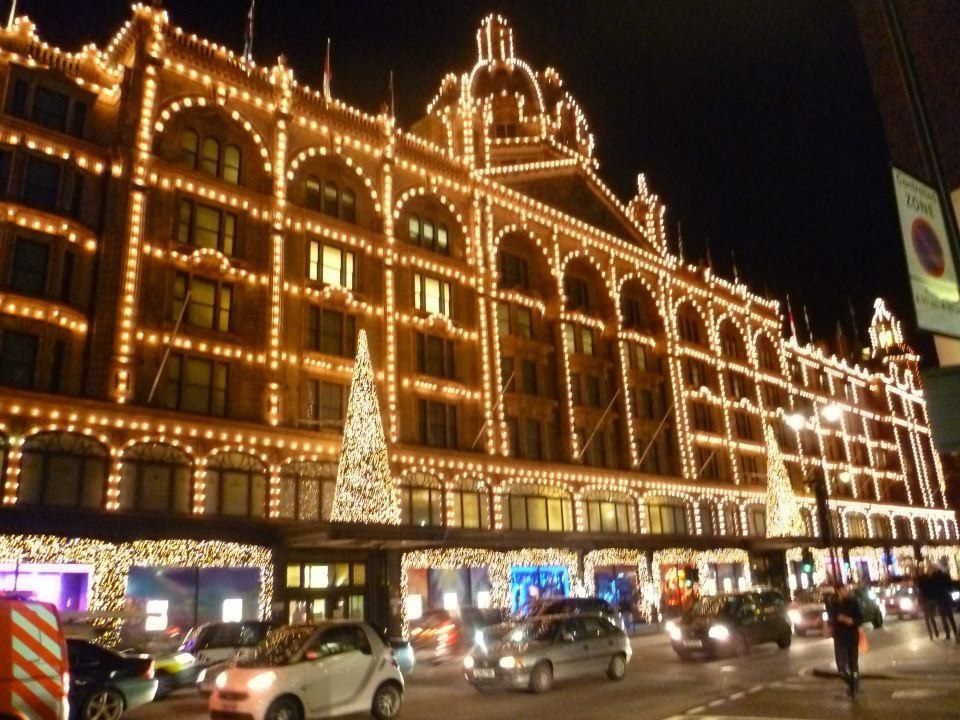 Harrods, the iconic shopping mall in London, at night with all the facade lit up for Christmas