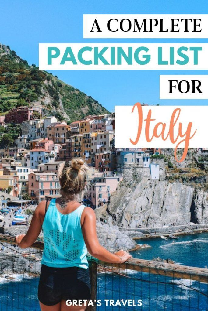 "Photo of a girl from the back looking at the colourful houses of Manarola in Cinque Terre with text overlay saying ""a complete packing list for Italy"""