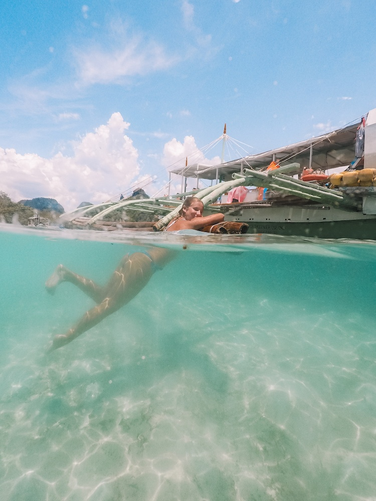Island hopping in El Nido, Philippines - 50/50 over under water photo taken with a GoPro dome