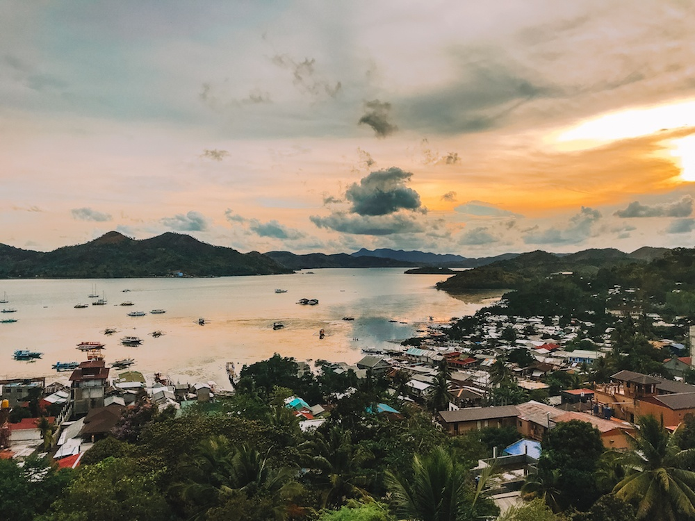 The sunset view from the rooftop bar of Hop Hostel in Coron
