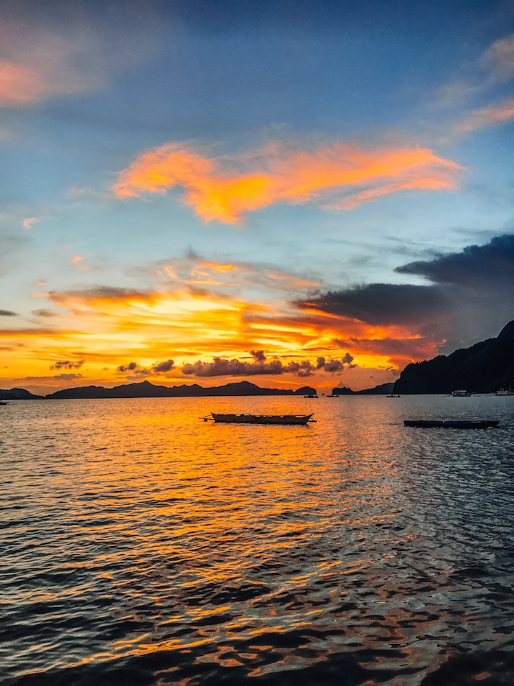 The sunset view from Outpost Beach Hostel in El Nido, Palawan