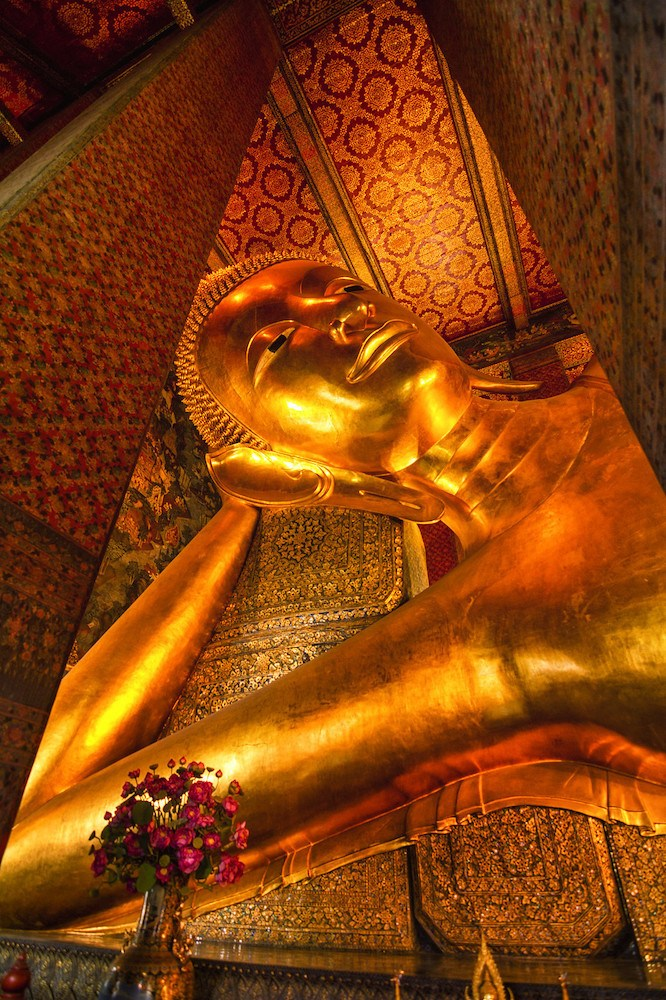 The huge gold reclining buddha of Wat Pho in Bangkok