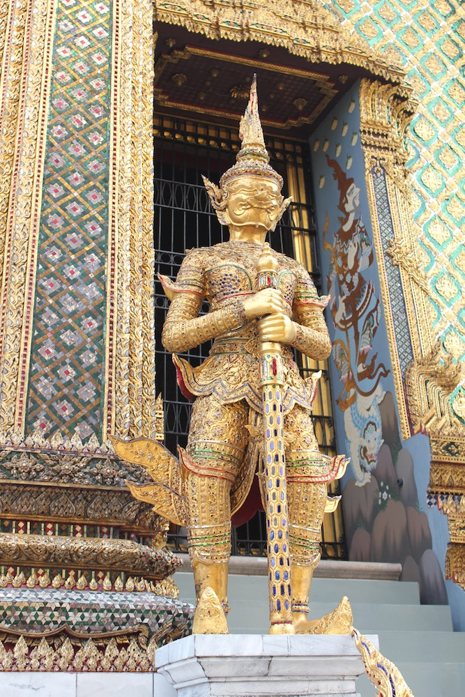 One of the golden statues at the Grand Palace in Bangkok - Photo by Angela Saran on Scopio