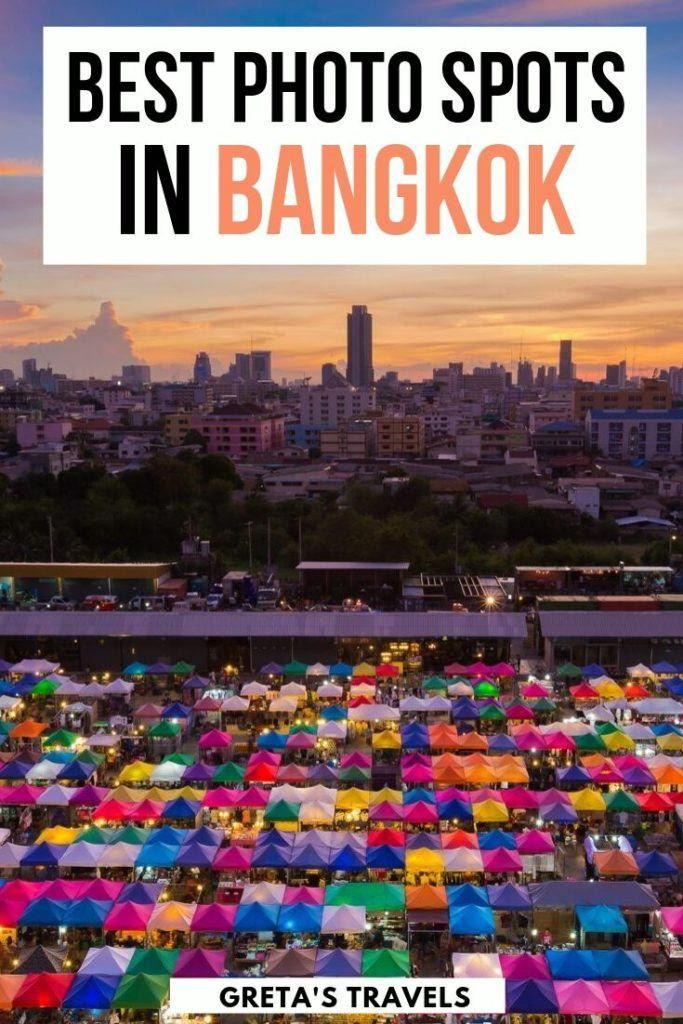 """View of Ratchada Night Market from above with the sunset and Bangkok skyline in the distance, with text overlay saying """"best photo spots in Bangkok"""""""