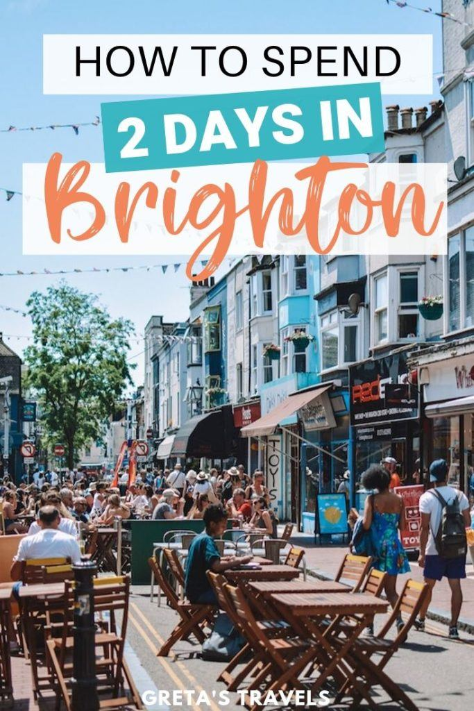 """One of the colourful and lively streets in the Lanes in Brighton, with outdoors seating and lots of people both sat down or walking around, with text overlay saying """"How to spend a weekend in Brighton"""""""