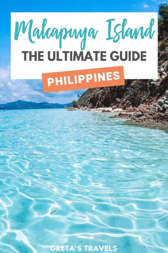 """Photo of the beach with the clear turquoise water of Malcapuya Island with text overlay saying """"Malcapuya Island: the ultimate guide, Philippines"""""""