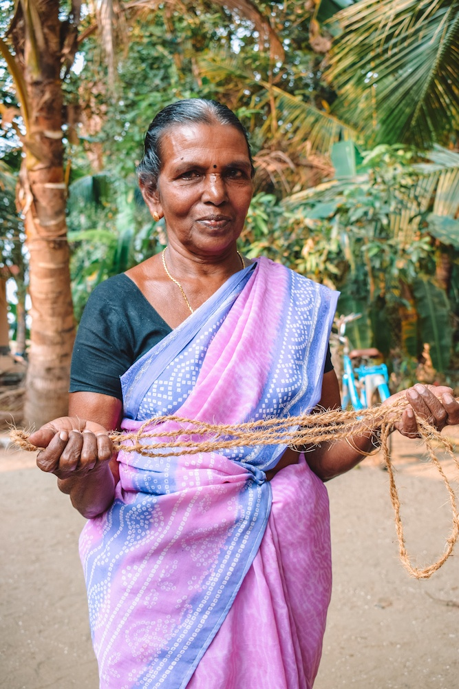 A local woman showing us how to weave coil ropes in a village in Kerala