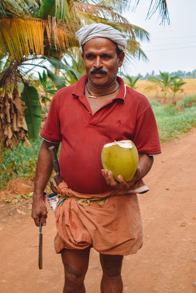 A local man in Kerala showed us how to slice open coconuts