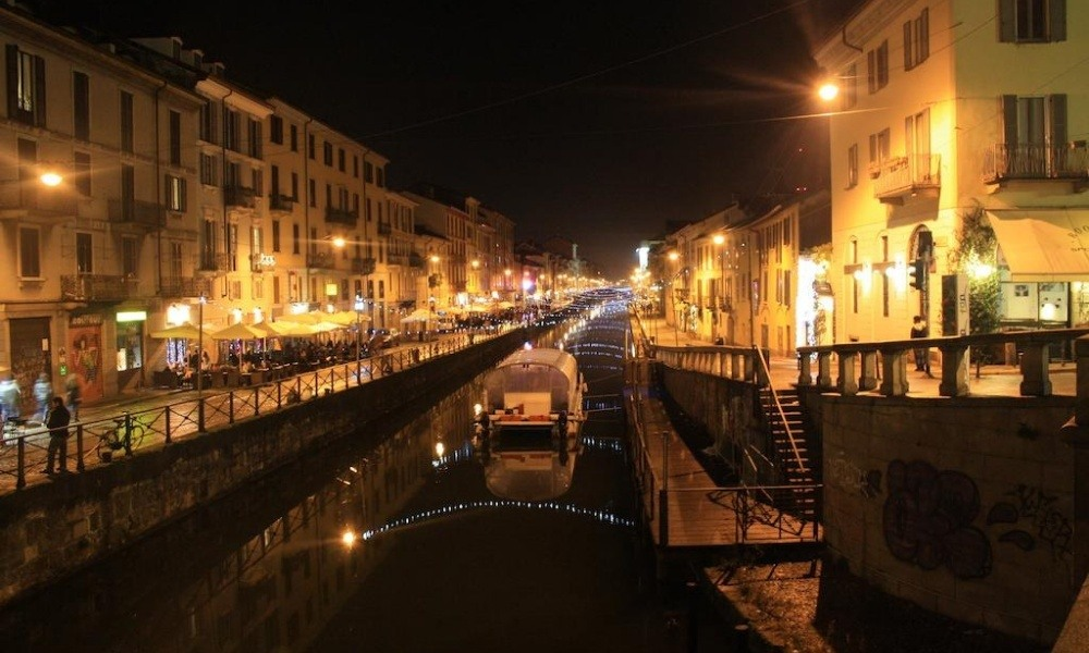 The canals of the Navigli in Milan lit up at night