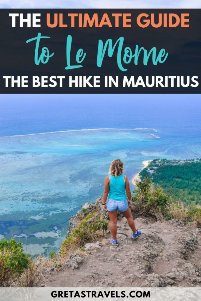 """Blonde girl standing at the top of Le Morne Brabant, overlooking the underwater waterfall of Mauritius, with text overlay saying """"the ultimate guide to Le Morne; the best hike in Mauritius"""""""