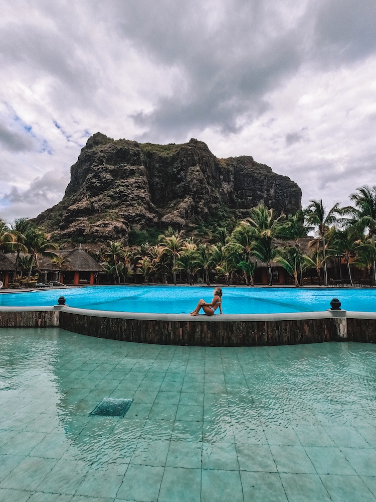 The main pool at the Dinarobin Beachcomber Resort, with Le Morne Brabant mountain right behind it!