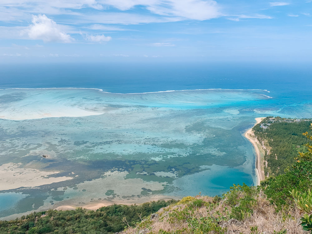 The coast of Mauritius and hundreds of different shades of blue as seen from the peak of Le Morne Brabant