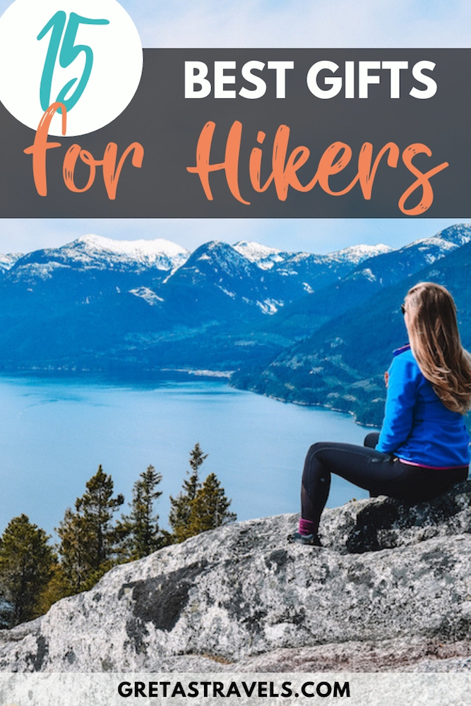 """Blonde girl overlooking the mountains and lake from the top of the First Peak in Canada, with text overlay saying """"15 best gifts for hikers"""""""