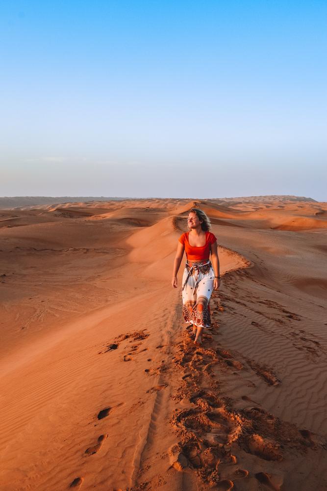 Exploring the sand dunes of the Al Wasil desert in Oman at sunrise