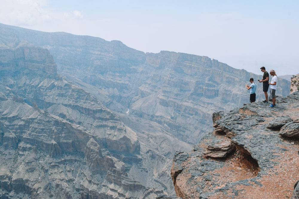 Standing on the edge of Wadi Ghul, Oman's Grand Canyon, from the viewpoint before the start of the Balcony Walk trail