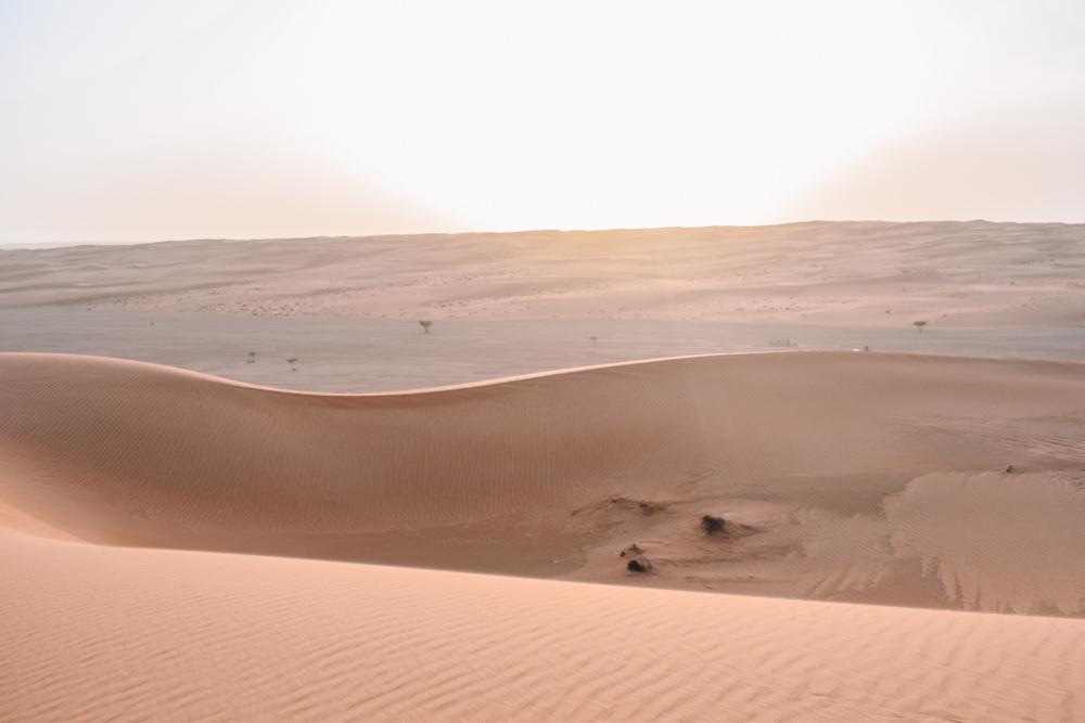 Sunrise over the sand dunes of the Al Wasil desert in Oman