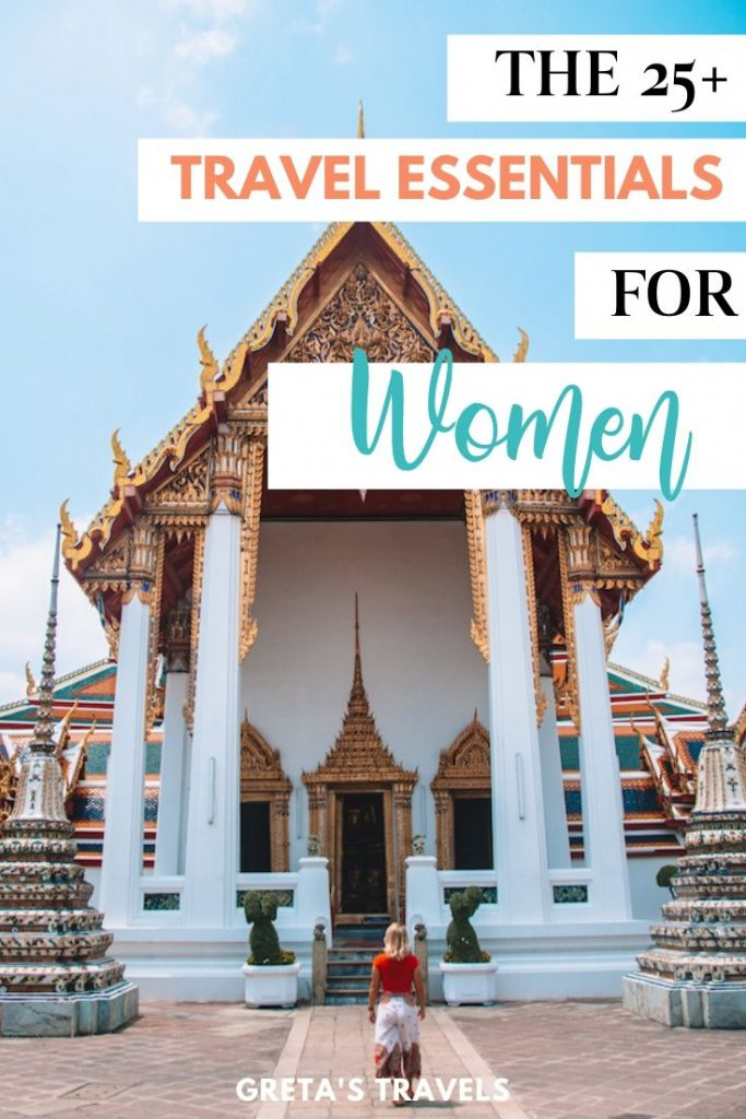 """Girl standing in front of Wat Pho temple in Bangkok with text overlay saying """"The 25+ travel essentials for women"""""""