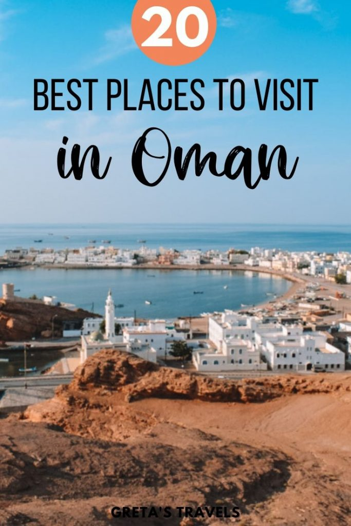 """View over the Sur harbour from one of the watch towers at sunset, with text overlay saying """"20 best places to visit in Oman"""""""