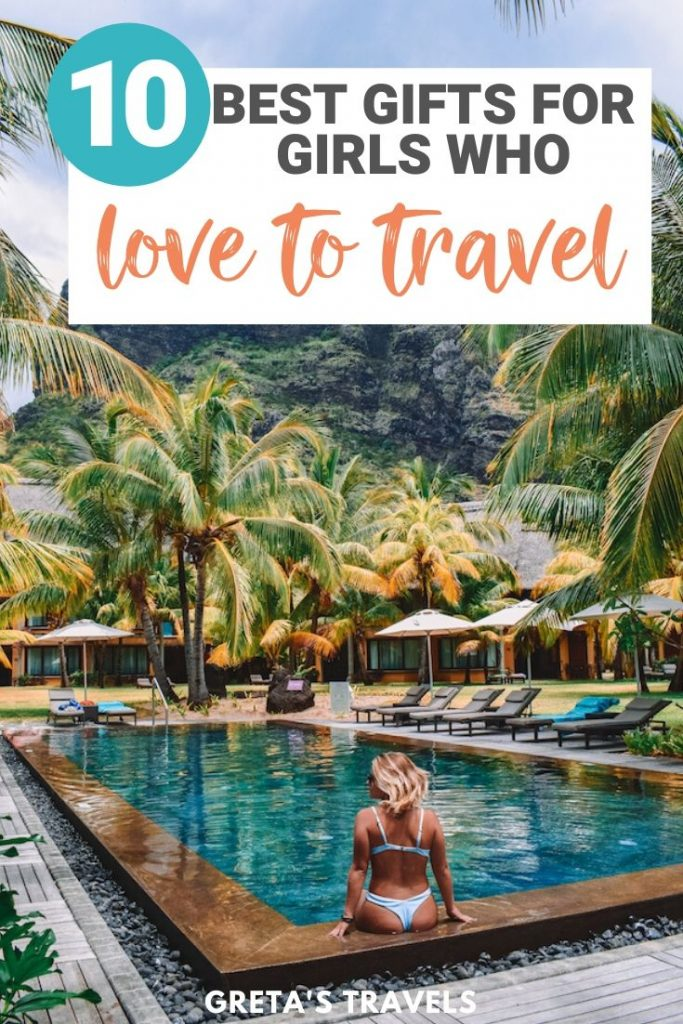 """Blonde girl sat on poolside with palm trees around her and text overlay saying """"10 best gifts for girls who love to travel"""""""