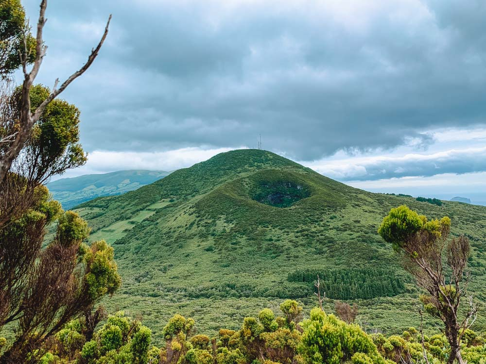 The volcano crates and lush green vegetation you'll see while hiking Cabeco do Canto on Faial Island