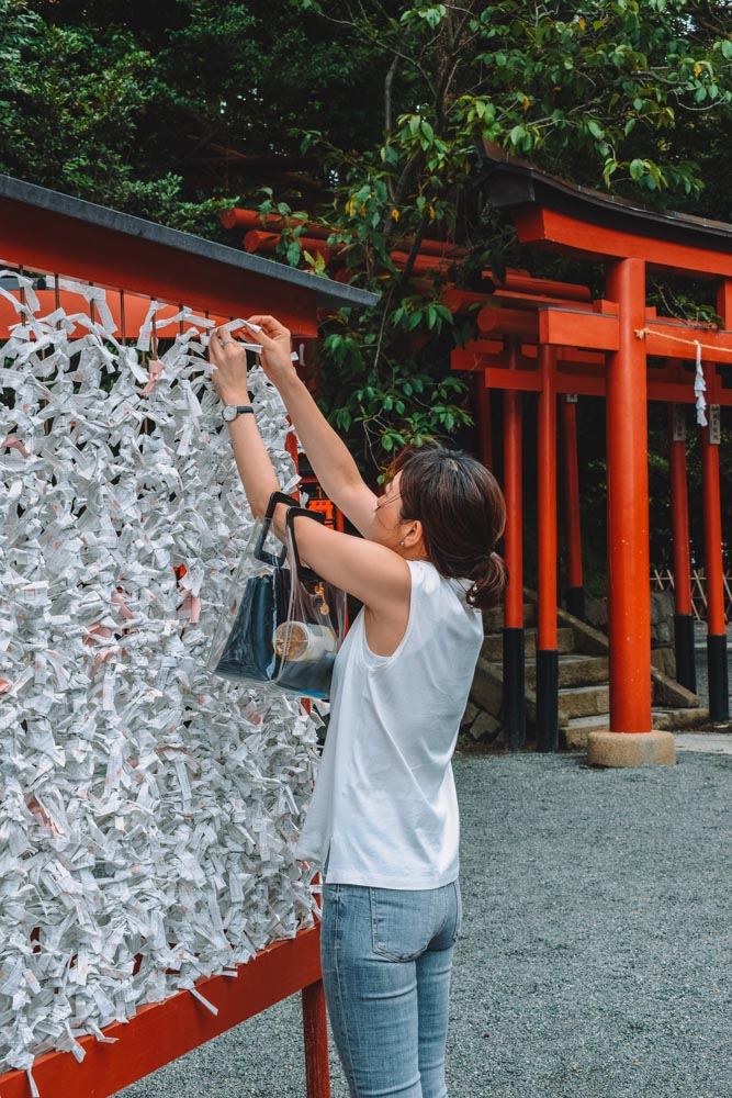 Tying wishes and offerings at Tsurugaoka Hachiman-gu Temple in Kamakura