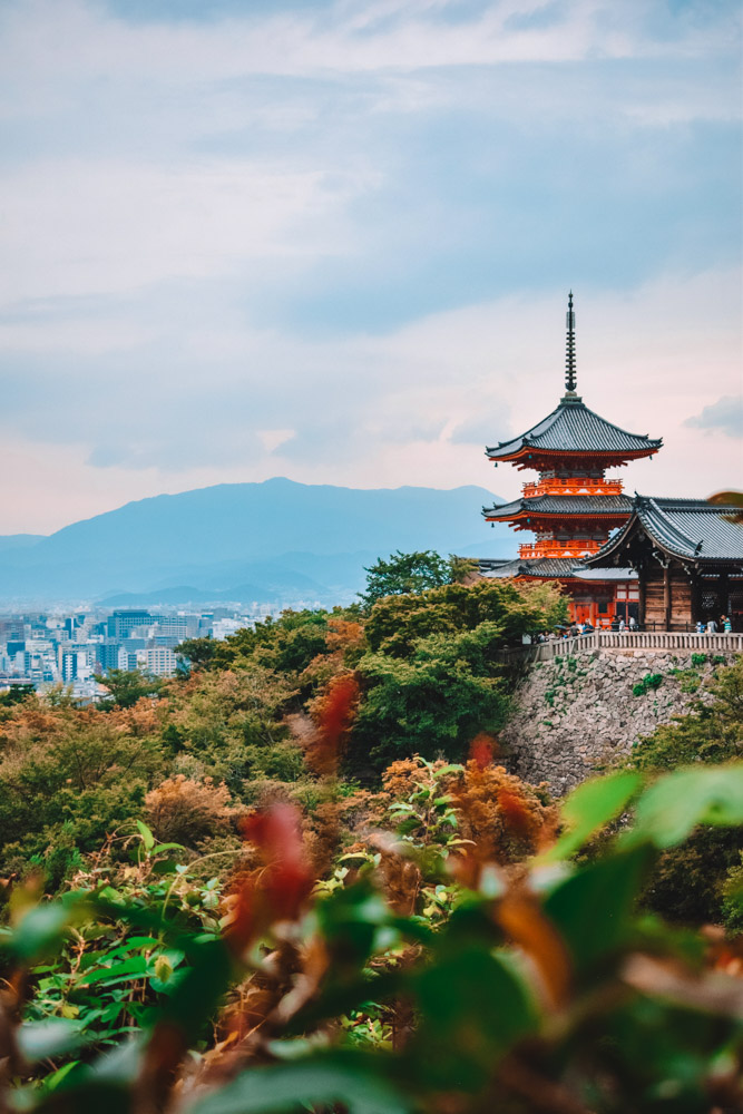The view from Kiyomizudera temple over its main pagoda with Kyoto in the background
