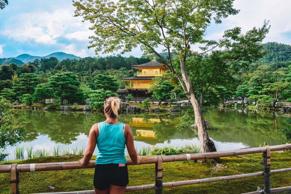 Admiring the Kinkaku-ji golden temple in Kyoto