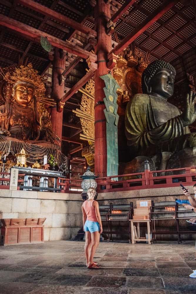 Admiring the giant statues inside Todaiji temple in Nara, Japan