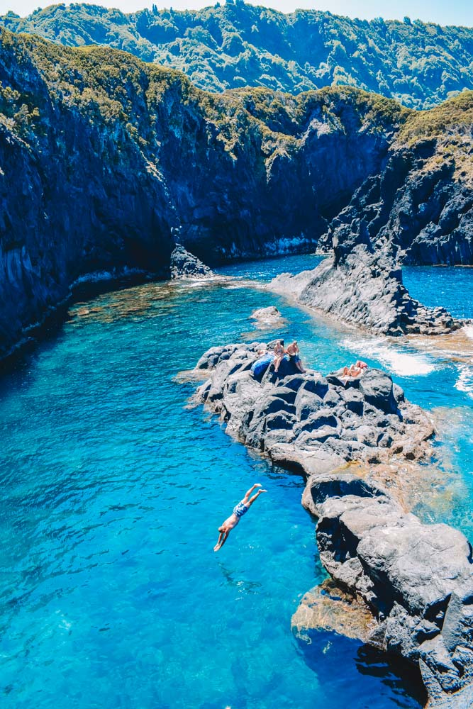 Diving in the clear water of the Simao Dias natural pools of Sao Jorge Island