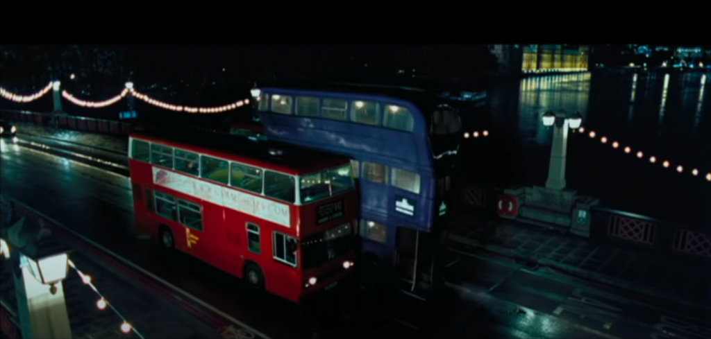 The Knight Bus squeezing between two red London buses in Harry Potter and the Prisoner of Azkaban
