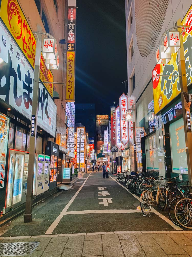 The brightly lit streets of Tokyo at night