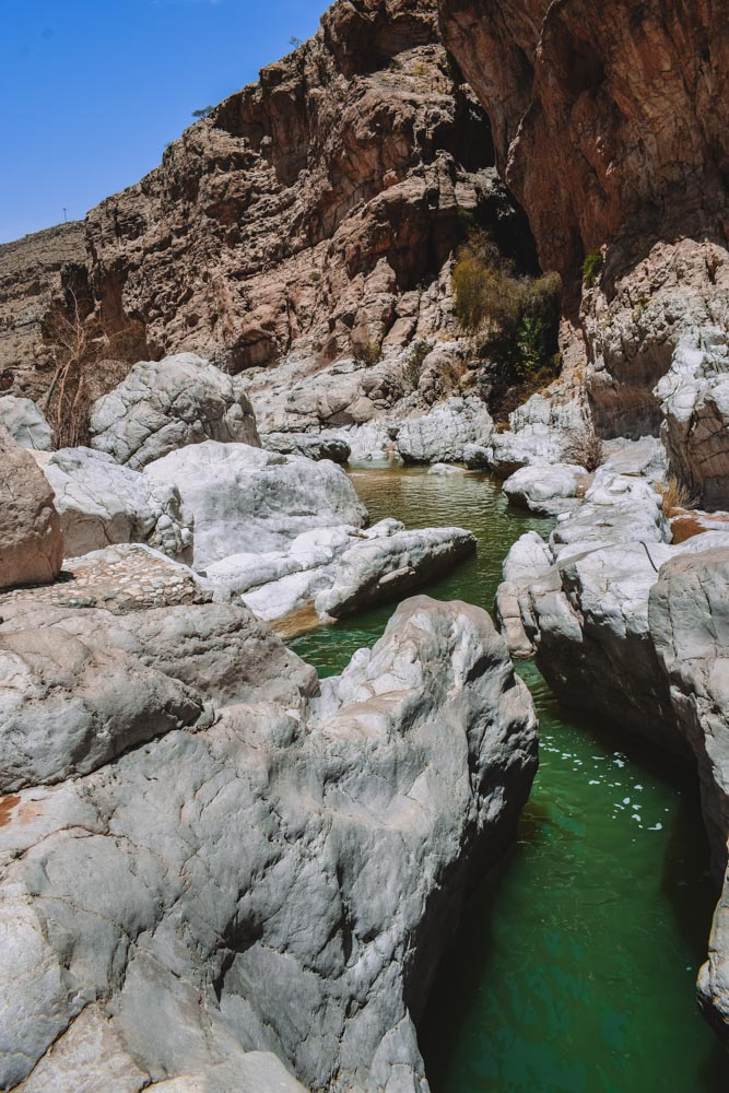 The emerald water and rocky canyon sides of Wadi Bani Khalid in Oman